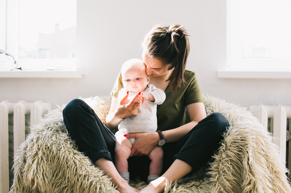 mother holding baby; Sleepy Bub's post on shaken baby syndrome